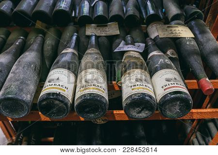 Bottles With Wine In The Wine Cellar