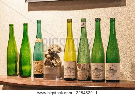 Collection Of Bottles From Wine Trimbach In The Tasting Room, France, Alsace. July 25, 2017