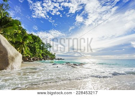 Paradise Tropical Beach With Rocks,palm Trees And Turquoise Water In Sunshine, Seychelles 24