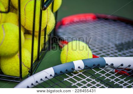 Close Up View Of Tennis Racket And Balls On Court