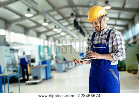 Technician Working Inmetal Industry Factory And Doing Quality Control