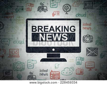 News Concept: Painted Black Breaking News On Screen Icon On Digital Data Paper Background With  Hand