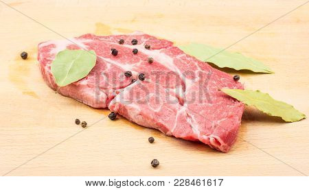 Raw Pork Neck Meat Cut With Black Pepper And Bay Leaves On Wood Background Fresh One Slice Without B