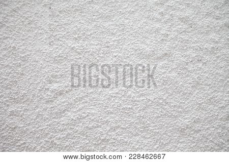 White Painted Grungy Concrete Wall Background. Background From High Detailed Fragment Wall. Cement W