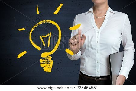 Light Bulb Concept Touchscreen Is Shown By Businesswoman.