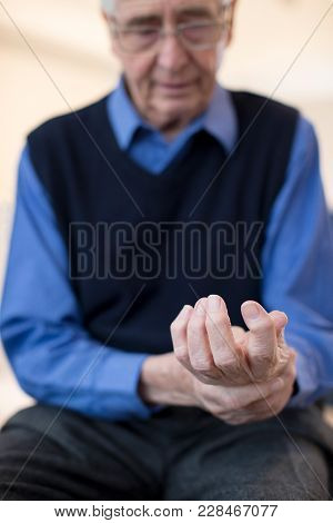 Senior Man At Home Suffering With Arthritis