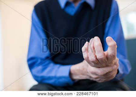 Close Up Of Senior Man At Home Suffering With Arthritis