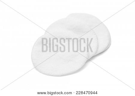 Round cotton cosmetic pads on white background, including clipping path