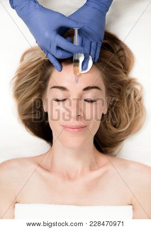 Botox woman fillers spa facial young treatment syringe injecting injection skin  poster