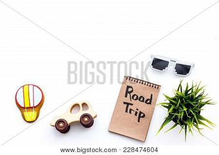 Family Trip Concept. Sun Glasses, Green Plant, Air Ballon Cookie, Car Toy. Road Trip Hand Lettering