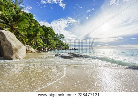 Paradise Tropical Beach With Rocks,palm Trees And Turquoise Water In Sunshine, Seychelles 15