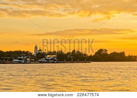 Yacht At The Pier At Sunset On Summer Evening