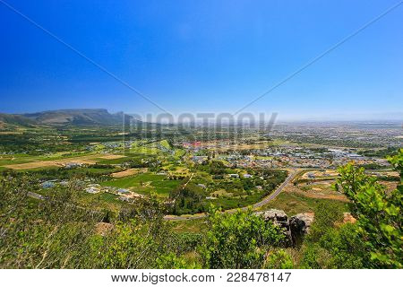 Elevated View From The Top Of A Mountain Of The Southern Suburbs Of Cape Town