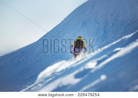 Freerider Snowboarder At Off-piste Slope. Backcountry Concept. Place For Text
