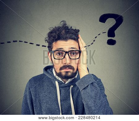 Young Hipster Man Having Question In Mind And Looking Puzzled At Camera.