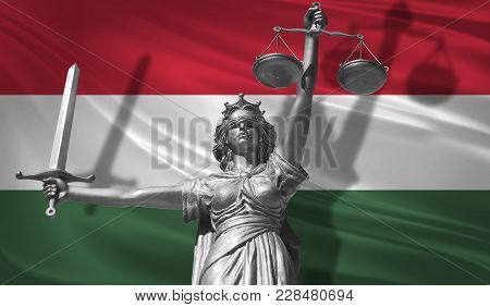 Cover About Law. Statue Of God Of Justice Themis With Flag Of Hungary Background. Original Statue Of
