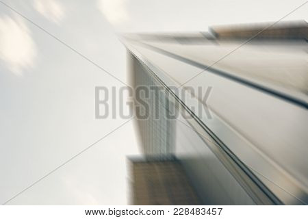 Abstract Image Of The Modern Glass Exterior Of A Skyscraper Rising Up To The Sky In The Commercial D
