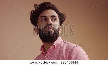 Man Touches His Hair An Looking At Camera. Good Groomed Man With Beard