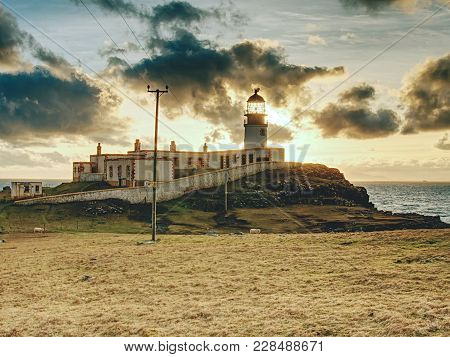 Old Landscape Lighthouse, White Light Tower With Building For Navigation On The Thin Spit Of Island,