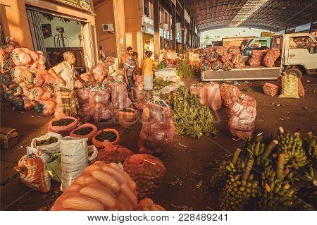 Dambulla, Sri Lanka - Jan 7, 2017: Traders Of Village Fruit Market And Many Fruits, Bags Of Pineappl