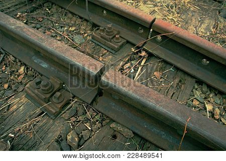 Detail Of Old Rusty Rails In Abandoned Railway Station.  Rusty Train Railway Detail, Granite Stones