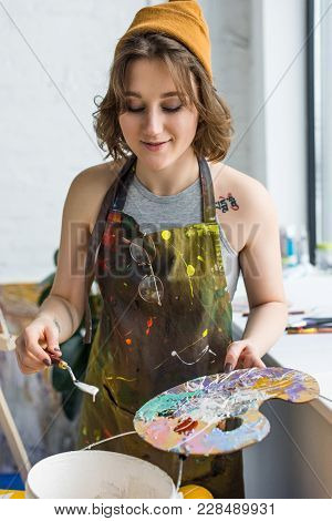 Young Creative Girl Working With Painting Knife And Palette In Light Studio