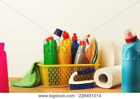 Bucket With Cleaning Items On Wood Table, Closeup. Bucket, Brush, Colourful Rags, Disinfection Produ