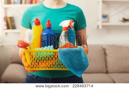 Young Woman Holding Bucket With Cleaning Items, Sponges And Rags In Hands, Close Up. Household Equip