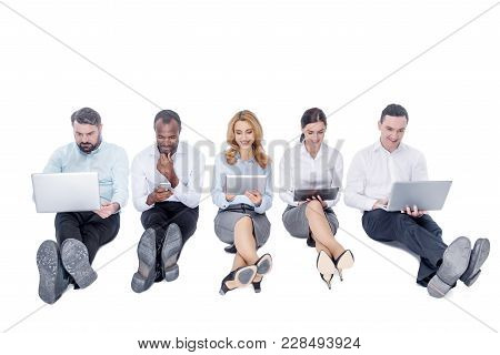 Working Day. Good-looking Inspired Stylish Young Co-workers Smiling And Working On Their Gadgets Whi