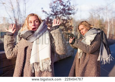 Collage Of Same Blond Woman Outdoors Threatening Her Alter Ego With A Gun