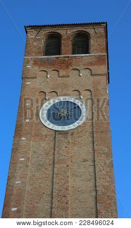 Bell Tower With Roman Numerals  In Downtown Of Chioggia Island Near Venice In Italy