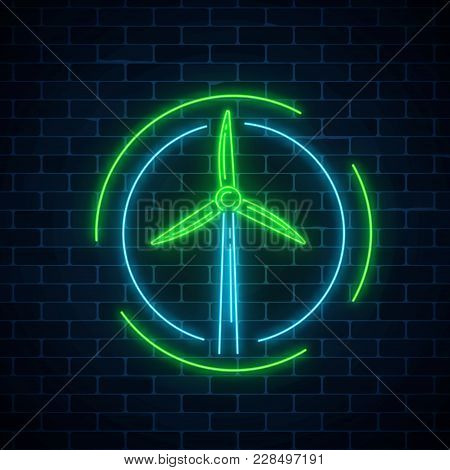 Glowing Neon Sign Of Windmill In Circle Frames On Dark Brick Wall Background. Ecology Wind Power Gen