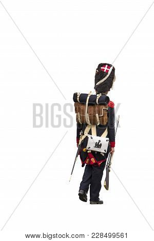 French Grenadier Walking Away And Pointing His Back To The Camera. Isolated On White Background.