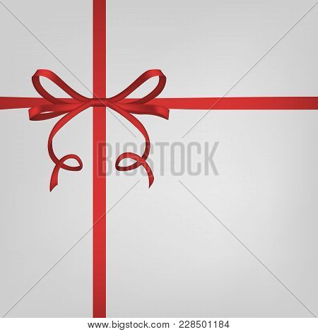 Holiday White Gift Box With Red Ribbon And Bow.
