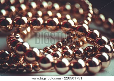 Golden Beads Valuable Necklace Lays On Light Surface