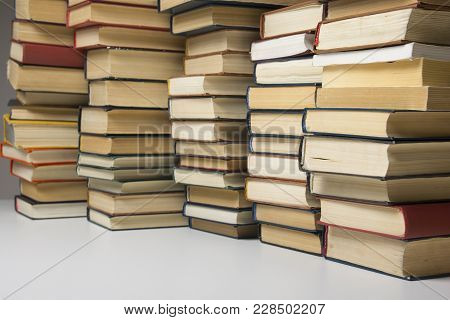 Stack Of Books Background. Many Books Piles
