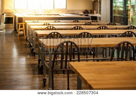 Empty Culinary School Classroom With Rows Of Tables And Chairs