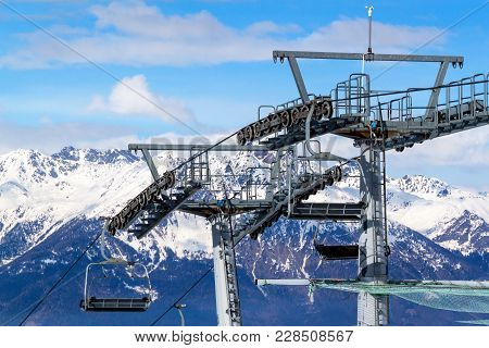 Chairlift In The Italian Alps. Chair Lift In Snowy Mountains At Nice Sunny Day