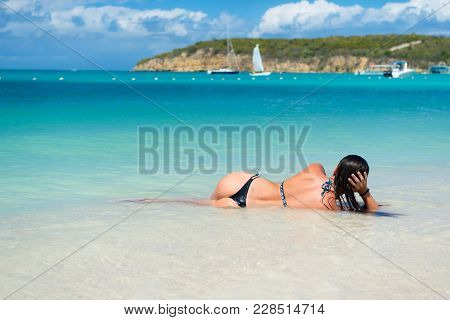 Woman With Sexi Ass Lie In Transparent Sea Or Ocean Water In Antigua Under Blue Sky On Idyllic Sunny