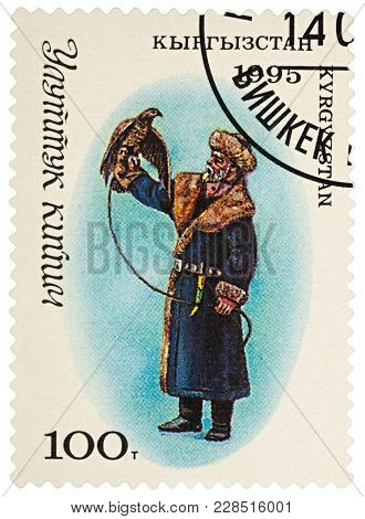 Moscow, Russia - February 26, 2018: A Stamp Printed In Kyrgyzstan, Shows Man-hunter In Traditional K