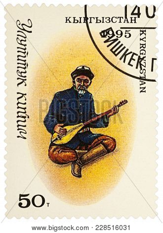 Moscow, Russia - February 26, 2018: A Stamp Printed In Kyrgyzstan, Shows Man In Traditional Kyrgyz C