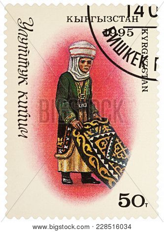 Moscow, Russia - February 26, 2018: A Stamp Printed In Kyrgyzstan, Shows Woman In Traditional Kyrgyz