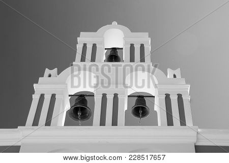 Unique Bell Tower Of A Small Church In Oia, Santorini Island, Greece