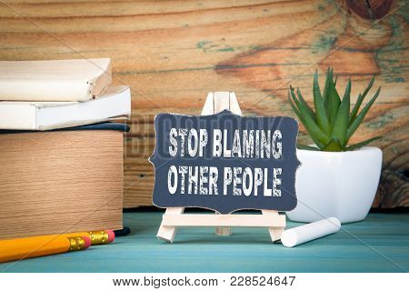 Stop Blaming Other People. Small Wooden Board With Chalk On The Table.