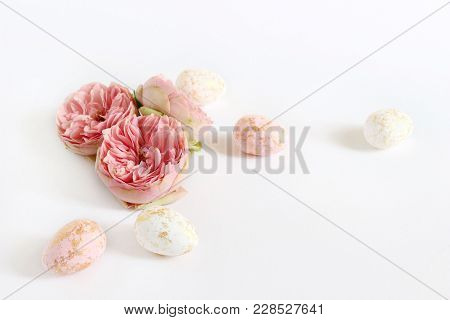 Spring Greeting Card, Invitation. Pink And White Easter Eggs With Golden Spots And Rose Flowers Lyin