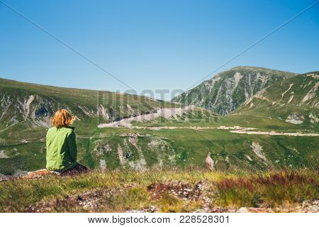 Woman Sits On The Top And Admires The Beautiful View Of Parang Mountains, Romania