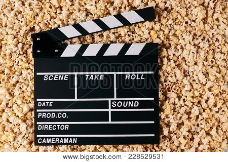 Movie Clapper Board And Pop Corn On Background With Copy Space, Top View. Movie Time Concept, Close-
