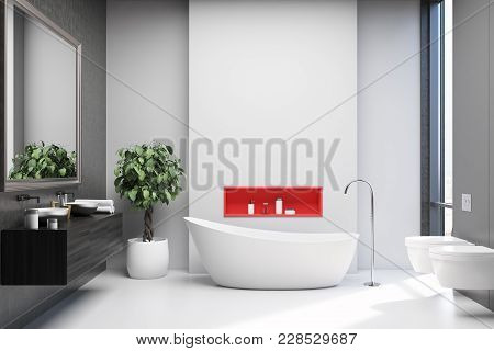 White And Gray Bathroom Interior With A White Floor, A White Tub, A Black Double Sink With A Large M