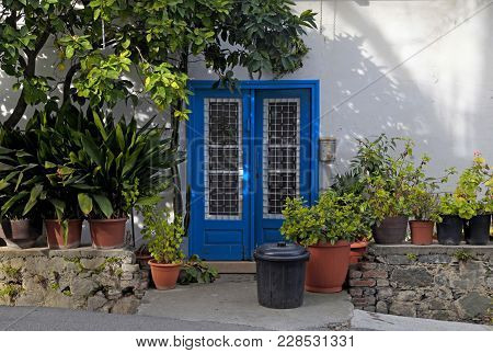 Vintage Blue Door In White Old House With Flowerpots In Kakopetria Village, Cyprus