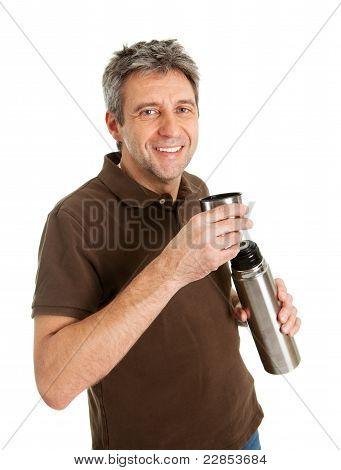 Portrait of senior man drinking coffee/tea